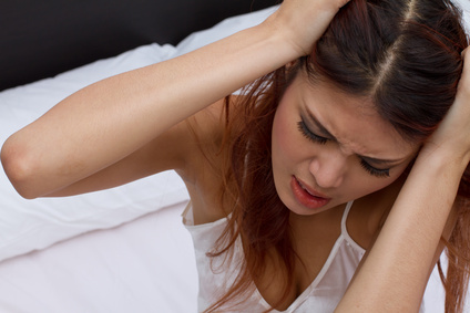 woman suffers from headache, migrain, emotional stress, insomnia or sleeplessness